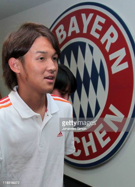 Takashi Usami new recruit of FC Bayern football club arrives for a photo call at Allianz arena on July 18 2011 in Munich Germany