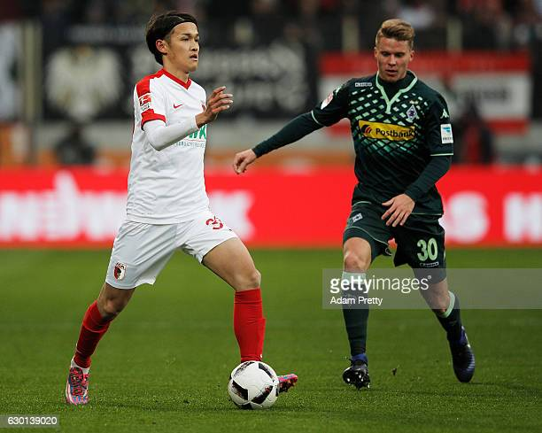Takashi Usami of Augsburg in action during the Bundesliga match between FC Augsburg and Borussia Moenchengladbach at WWK Arena on December 17, 2016...