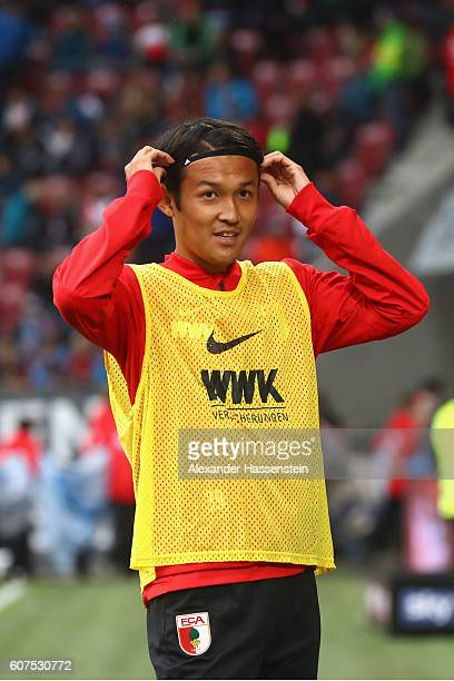 Takashi Usami of Augsburg looks on prior to the Bundesliga match between FC Augsburg and 1 FSV Mainz 05 at WWK Arena on September 18 2016 in Augsburg...