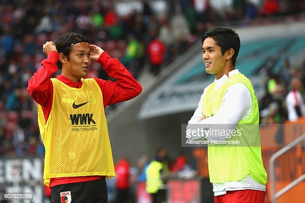 Takashi Usami of Augsburg talks to Yoshinori Muto of Mainz prior to the Bundesliga match between FC Augsburg and 1 FSV Mainz 05 at WWK Arena on...