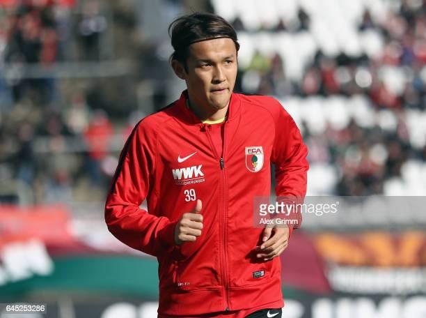 Takashi Usami of Augsburg warms up prior to the Bundesliga match between SV Darmstadt 98 and FC Augsburg at JonathanHeimesStadion am Boellenfalltor...