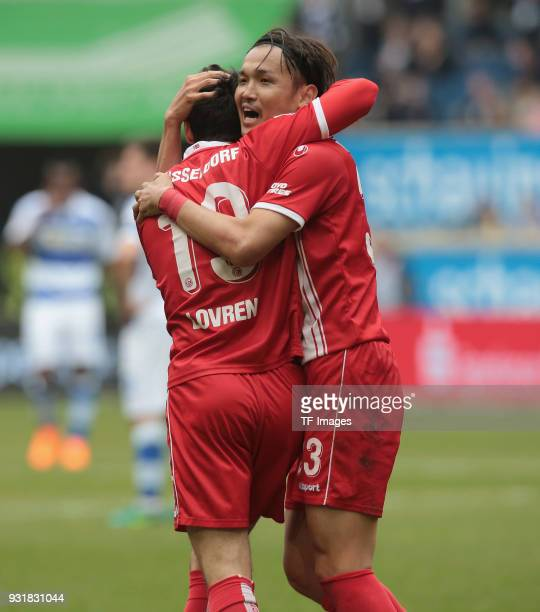 Takashi Usami of Duesseldorf celebrates after scoring his team`s second goal with Lovren of Duesseldorf during the Second Bundesliga match between...