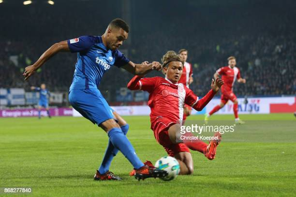 Takashi Usami of Duesseldorf challenges Jan Gyamerah of Bochum during the Second Bundesliga match between VfL Bochum 1848 and Fortuna Duesseldorf at...