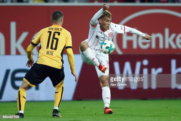 Takashi Usami of Duesseldorf is challenged by Philip Heise of Dresden during the Second Bundesliga match between Fortuna Duesseldorf and SG Dynamo...