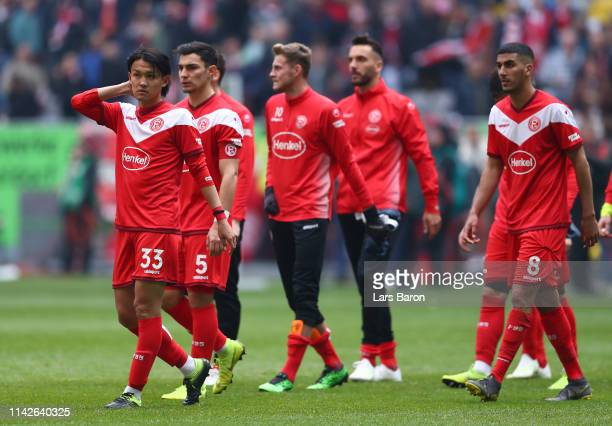 Takashi Usami of Duesseldorf looks dejected with his teamates during the Bundesliga match between Fortuna Duesseldorf and FC Bayern Muenchen at...