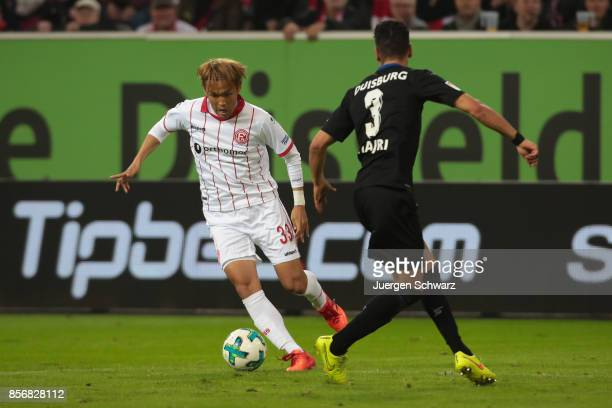 Takashi Usami of Duesseldorf moves the ball against Enis Hajri of Duisburg during the Second Bundesliga match between Fortuna Duesseldorf and MSV...