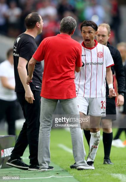 Takashi Usami of Duesseldorf reacts after his substitution of head coach Friedhelm Funkel of Duesseldorf during the Second Bundesliga match between...