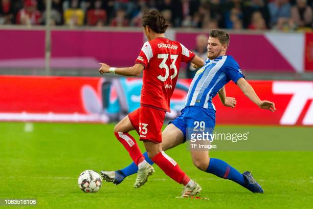 Takashi Usami of Fortuna Duesseldorf and Florian Baak of Hertha BSC Berlin battle for the ball during the Telekom Cup 2019 3rd Place match between...