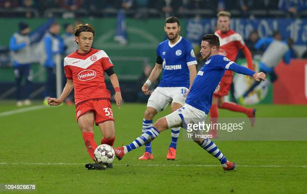 Takashi Usami of Fortuna Duesseldorf and Mark Uth of Schalke 04 battle for the ball during the DFB Pokal Cup match between FC Schalke 04 and Fortuna...