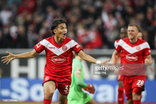 Takashi Usami of Fortuna Duesseldorf celebrates after scoring his team's first goal during the Bundesliga match between Fortuna Duesseldorf and...