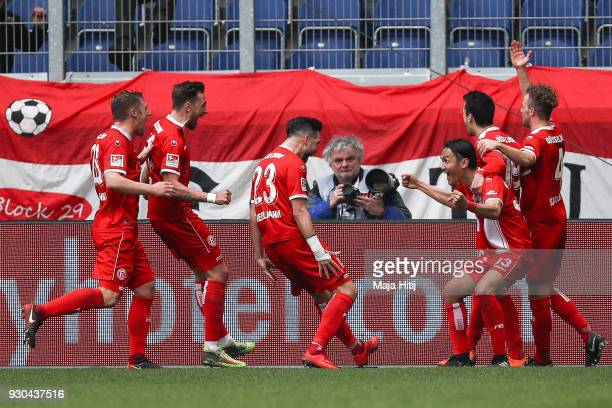 Takashi Usami of Fortuna Duesseldorf celebrates with his team mates after scoring his teams second goal to make it 02 during the Second Bundesliga...
