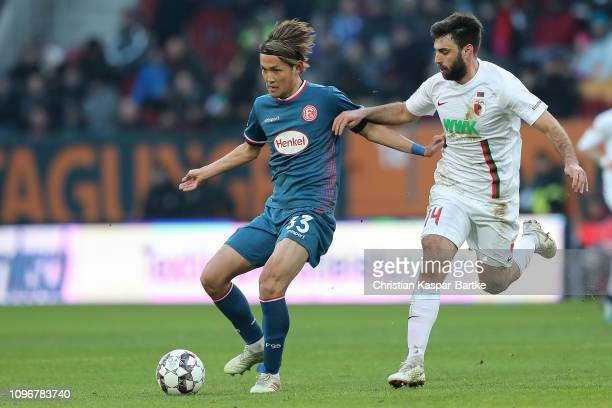 Takashi Usami of Fortuna Duesseldorf challenges Jan Moravek of FC Augsburg during the Bundesliga match between FC Augsburg and Fortuna Duesseldorf at...
