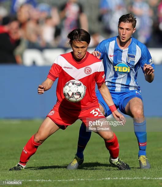 Takashi Usami of Fortuna Duesseldorf is put under pressure during the Bundesliga match between Hertha BSC and Fortuna Duesseldorf at Olympiastadion...