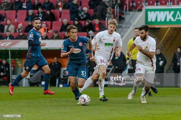 Takashi Usami of Fortuna Duesseldorf Martin Hinteregger of FC Augsburg and Jan Moravek of FC Augsburg battle for the ball during the Bundesliga match...