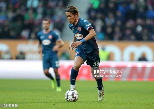 Takashi Usami of Fortuna Duesseldorf runs with the ball during the Bundesliga match between FC Augsburg and Fortuna Duesseldorf at WWKArena on...