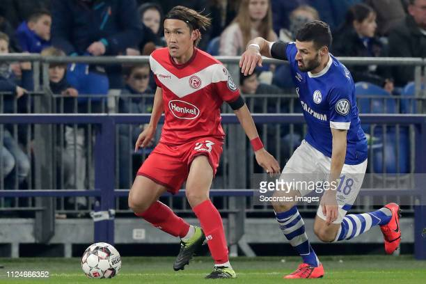 Takashi Usami of Fortuna Dusseldorf Daniel Caligiuri of Schalke 04 during the German DFB Pokal match between Schalke 04 v Fortuna Dusseldorf at the...