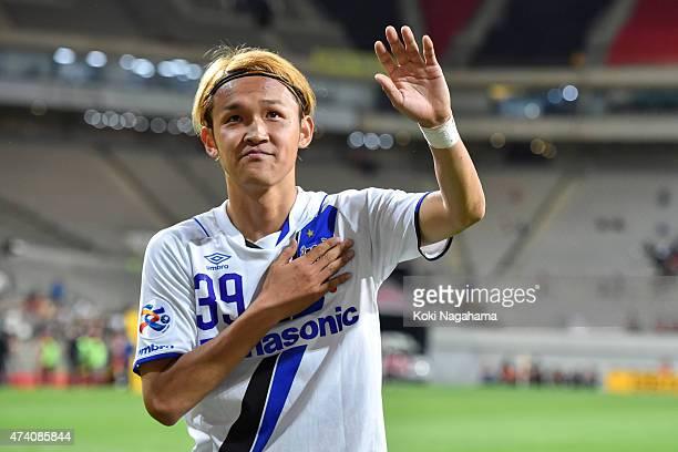 Takashi Usami of Gamba Osaka celebrates with supporters the victory after the AFC Champions League Round of 16 match between FC Seoul and Gamba Osaka...
