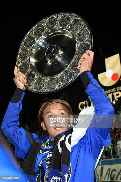 Takashi Usami of Gamba Osaka holds schale as J1 Champions during the J.League match between Tokushima Vortis and Gamba Osaka at Naruto Otsuka Sports...