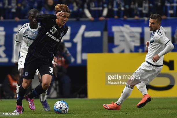 Takashi Usami of Gamba Osaka in action during the AFC Champions League Group G match between Gamba Osaka and Melbourne Victory at Suita City Stadium...