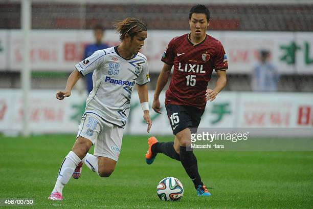 Takashi Usami of Gamba Osaka in action during the JLeague match between Kashima Antlers and Gamba Osaka at Kashima Stadium on October 5 2014 in...
