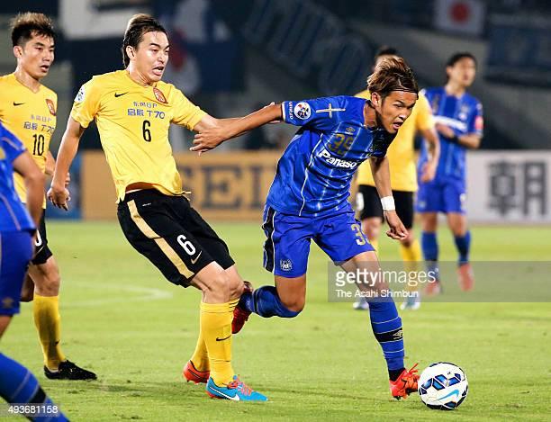 Takashi Usami of Gamba Osaka runs with the ball during the AFC Champions League semi final second leg match between Gamba Osaka and Guangzhou...