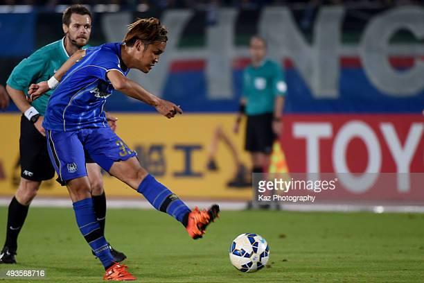 Takashi Usami of Gamba Osaka shoots the ball during the AFC Champions League semi final match between Gamba Osaka and Guangzhou Evergrande at the...