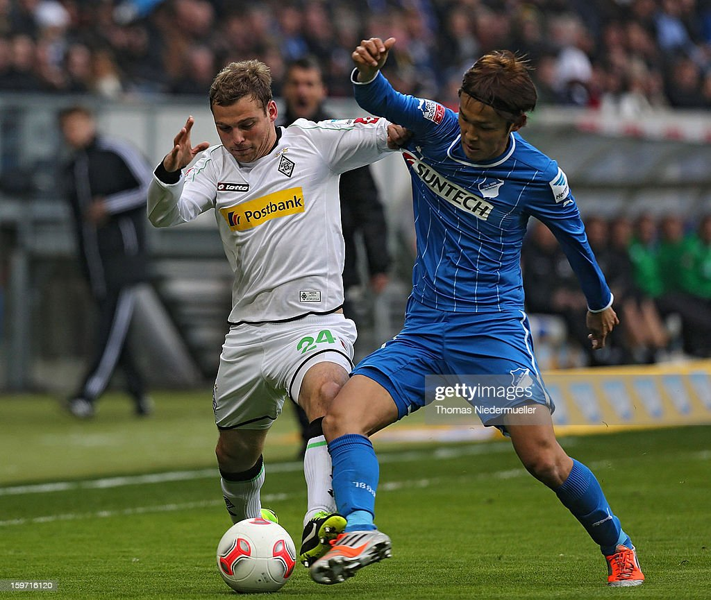 Takashi Usami (R) of Hoffenheim fights for the ball with Tony Janitschke (L) oh Moenchengladbach during the Bundesliga match between TSG 1899 Hoffenheim and VfL Borussia Moenchengladbach at Rhein-Neckar-Arena on January 19, 2013 in Sinsheim, Germany.
