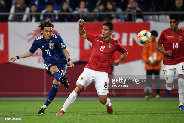 Takashi Usami of Japan attempts a shot during the international friendly match between Japan and Bolivia at Noevir Stadium Kobe on March 26 2019 in...