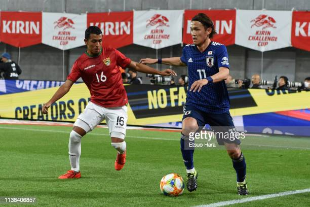 Takashi Usami of Japan controls a ball during the international friendly match between Japan and Bolivia at Noevir Stadium Kobe on March 26 2019 in...