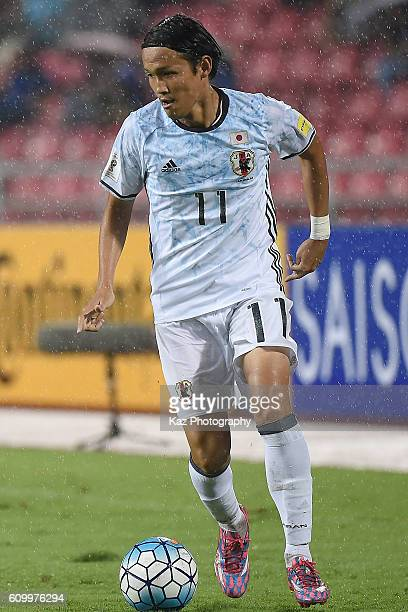 Takashi Usami of Japan dribbles the ball during the 2018 FIFA World Cup Qualifier between Thailand and Japan at the Rajamangala National Stadium on...