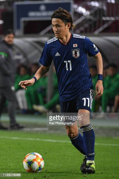 Takashi Usami of Japan dribbles the ball during the international friendly match between Japan and Bolivia at Noevir Stadium Kobe on March 26 2019 in...
