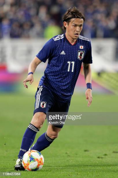 Takashi Usami of Japan in action during the international friendly match between Japan and Bolivia at Noevir Stadium Kobe on March 26, 2019 in Kobe,...