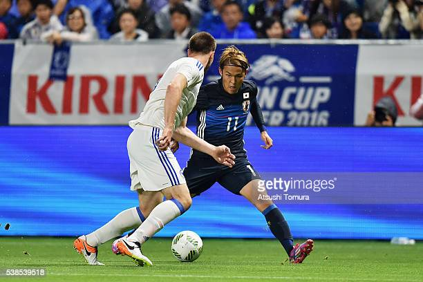 Takashi Usami of Japan in action during the international friendly match between Japan and Bosnia and Herzegovina at the Suita City Football Stadium...