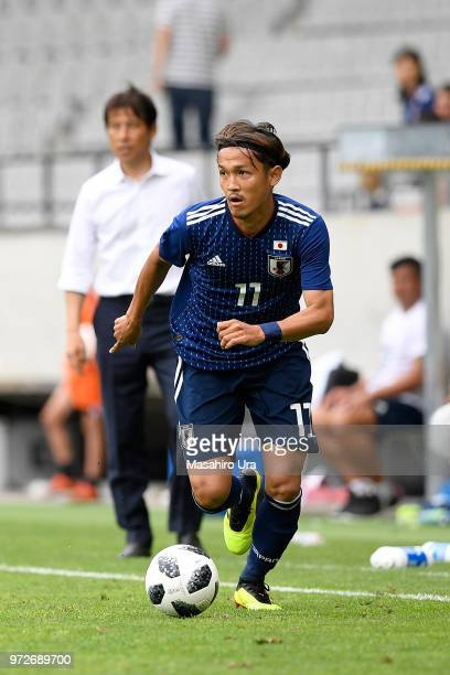 Takashi Usami of Japan in action during the international friendly match between Japan and Paraguay at Tivoli Stadion on June 12, 2018 in Innsbruck,...