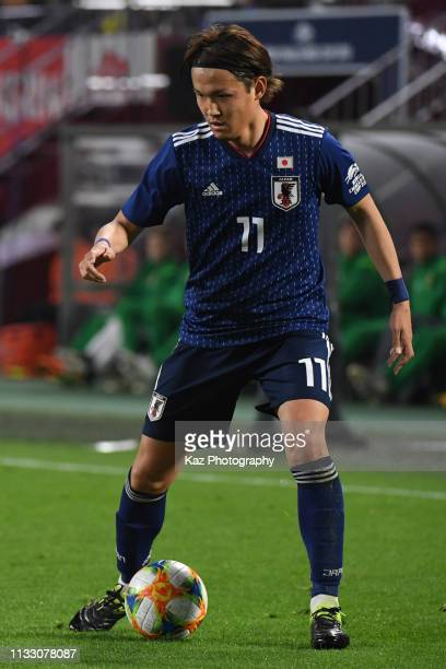 Takashi Usami of Japan keeps the ball during the international friendly match between Japan and Bolivia at Noevir Stadium Kobe on March 26 2019 in...