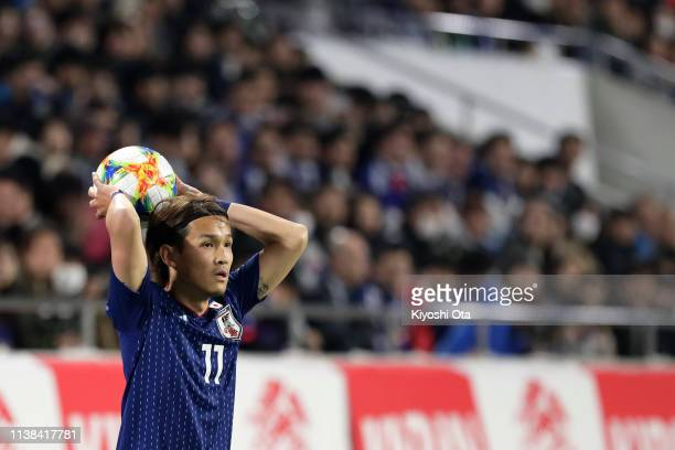 Takashi Usami of Japan prepares to do a throw-in during the international friendly match between Japan and Bolivia at Noevir Stadium Kobe on March...