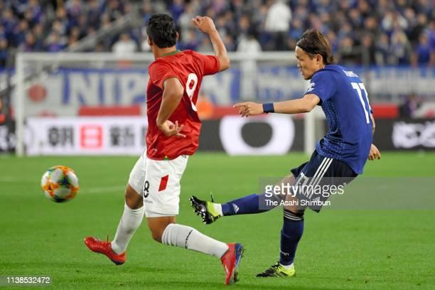 Takashi Usami of Japan shoots at goal during the international friendly match between Japan and Bolivia at Noevir Stadium Kobe on March 26 2019 in...