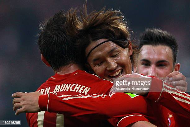 Takashi Usami of Muenchen celebrates scoring the 6th goal with his team mates Ivica Olic and Diego Contento during the DFB Cup second round match...
