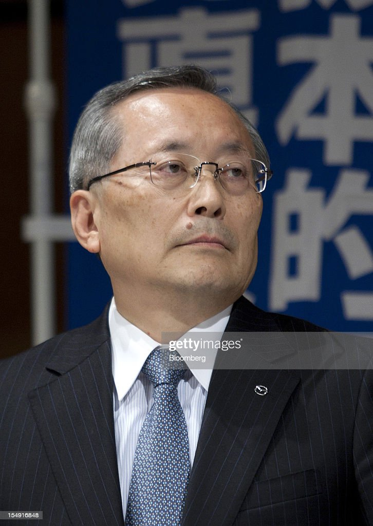 Takashi Yamanouchi, chief executive officer of Mazda Motor Corp., attends a joint news conference hosted by the Japan Automobile Manufacturers Association Inc. (JAMA) in Tokyo, Japan, on Monday, Oct. 29, 2012. Toyota and other Japanese carmakers reiterated their call for the government to scrap vehicle taxes to spur domestic demand. Photographer: Tomohiro Ohsumi/Bloomberg via Getty Images