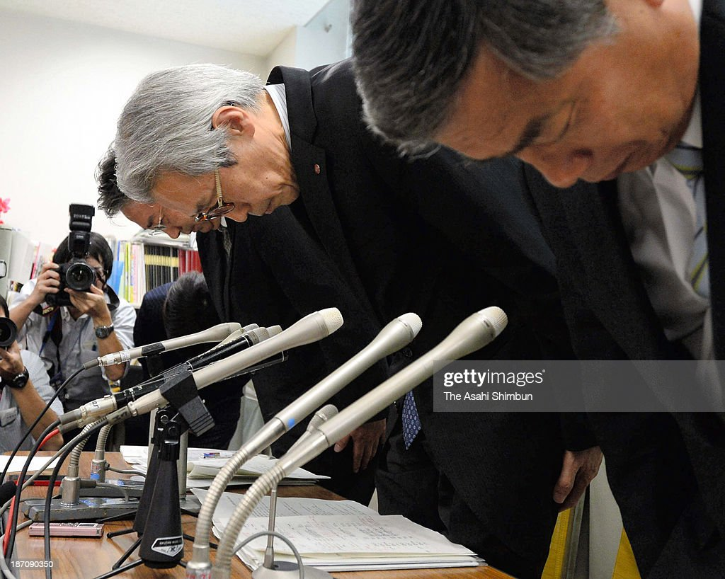 Takashimaya department store managing director Yutaka Masuyama (C) and other executives apologize after admitting to falsely labeling food products at their outlets during a news conference on November 5, 2013 in Tokyo, Japan. An internal investigation by Takashimaya officials found that a total of 62 menu items at 10 restaurants and prepared food shops in those six outlets had fake labels, such as a terrine using black tiger shrimp for a dish labeled 'Kurumaebi (Japanese tiger prawn)'. The latest menu mislabeling scandal surfaced late last month, when Hankyu Hanshin Hotels Co. announced that 47 food items served at its hotels, became a nationwide growing scandal that has sparked consumer outrage and prompted government calls for industry-wide investigations. Japan has no legislation stipulating clear standards for menu displays at restaurants, meaning that the companies did not necessarily violate the law.