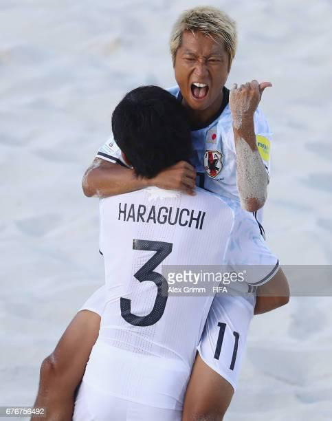 Takasuke Goto of Japan celebrates a goal with team mate Shotaro Haraguchi during the FIFA Beach Soccer World Cup Bahamas 2017 group D match between...