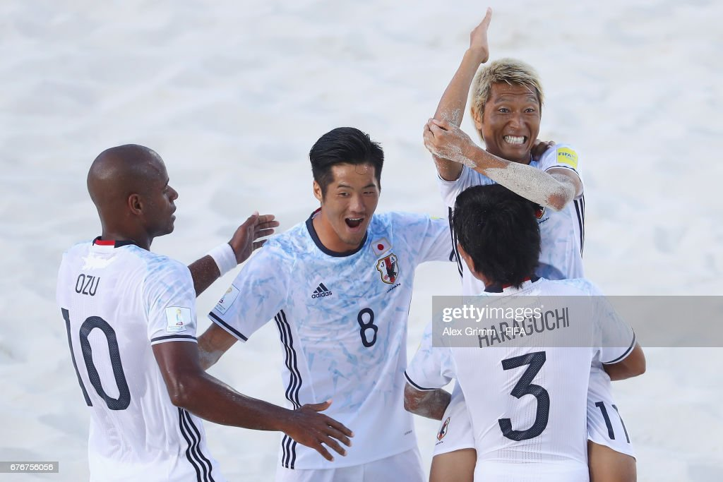 Takasuke Goto #11 of Japan celebrates a goal with team mates Ozu Moreira, Takaaki Oba and Shotaro Haraguchi during the FIFA Beach Soccer World Cup Bahamas 2017 group D match between Brazil and Japan at National Beach Soccer Arena at Malcolm Park on May 2, 2017 in Nassau, Bahamas.
