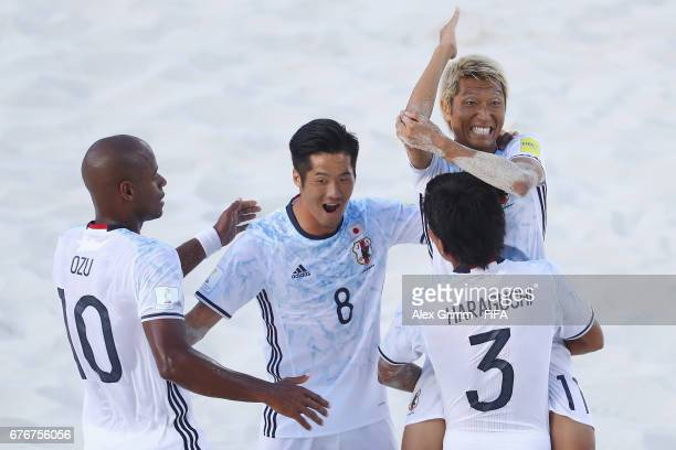 Takasuke Goto of Japan celebrates a goal with team mates Ozu Moreira Takaaki Oba and Shotaro Haraguchi during the FIFA Beach Soccer World Cup Bahamas...