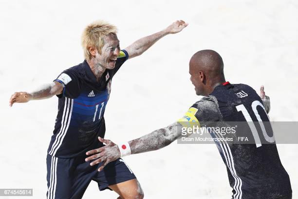Takasuke Goto of Japan celebrates scoring a goal with team mate Ozu Moreira during the FIFA Beach Soccer World Cup Bahamas 2017 group D match between...