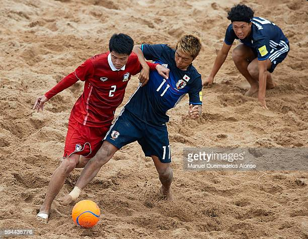 Takasuke Goto of Japan competes for the ball with Watchara Lepaijit of Thailand during the Continental Beach Soccer Tournament match between Japan...