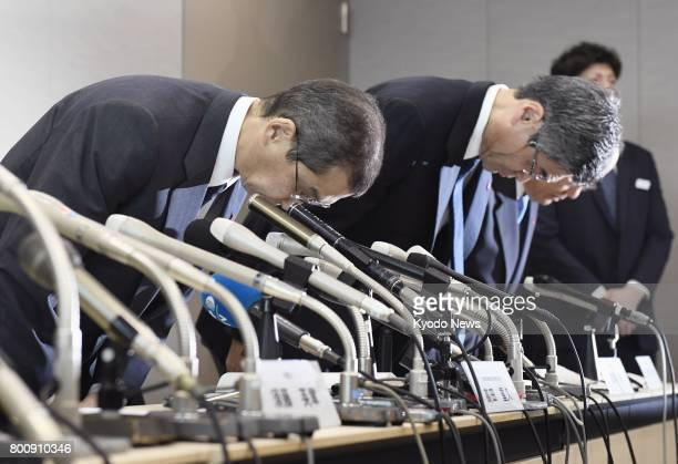 Takata Corp Chairman and Chief Executive Officer Shigehisa Takada and other executives bow in apology at a press conference in Tokyo on June 26 after...