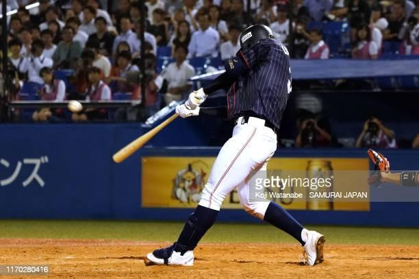 Takaya Ishikawa of Samurai Japan U-18 hits a RBI double to make it 4-3 in the 5th inning during the game between Samurai Japan Collegiate and Samurai...