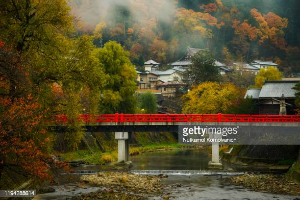 takayama red old and historical bridge in the morning of autumn - takayama city stock pictures, royalty-free photos & images