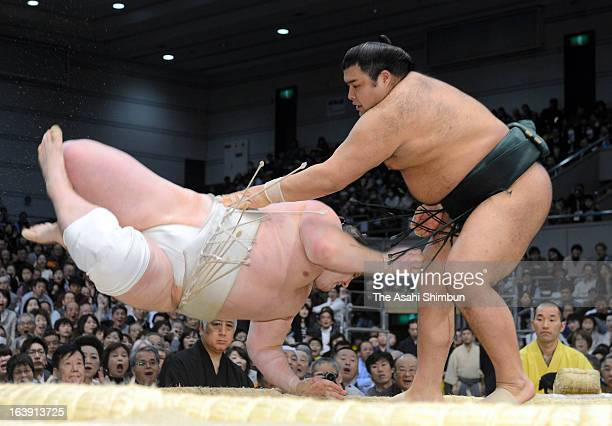 Takayasu throws Baruto to win in day seven of the Grand Sumo Spring Tournament at Osaka Prefectural Gymnasium on March 16 2013 in Osaka Japan