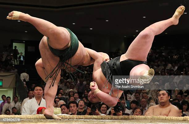 Takayasu throws Ikioi to win in day five of the Grand Sumo Summer Tournament at Ryogoku Kokugikan on May 14 2015 in Tokyo Japan